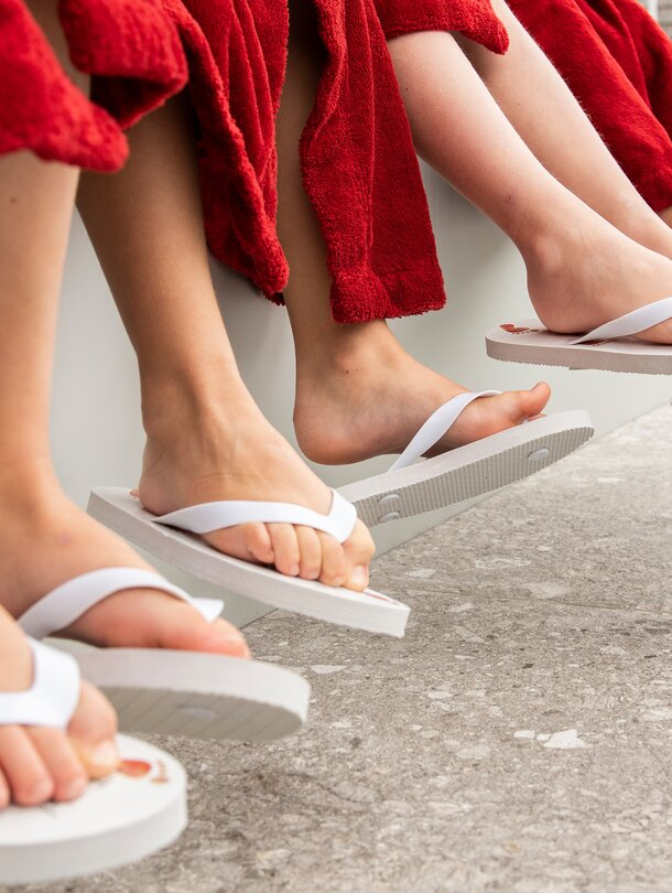 children with flip-flops on a wellness holiday